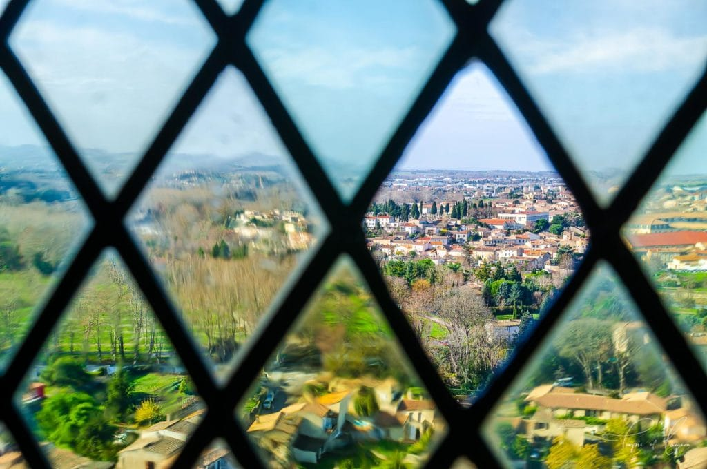 View through glass window to town of Carcassonne, France
