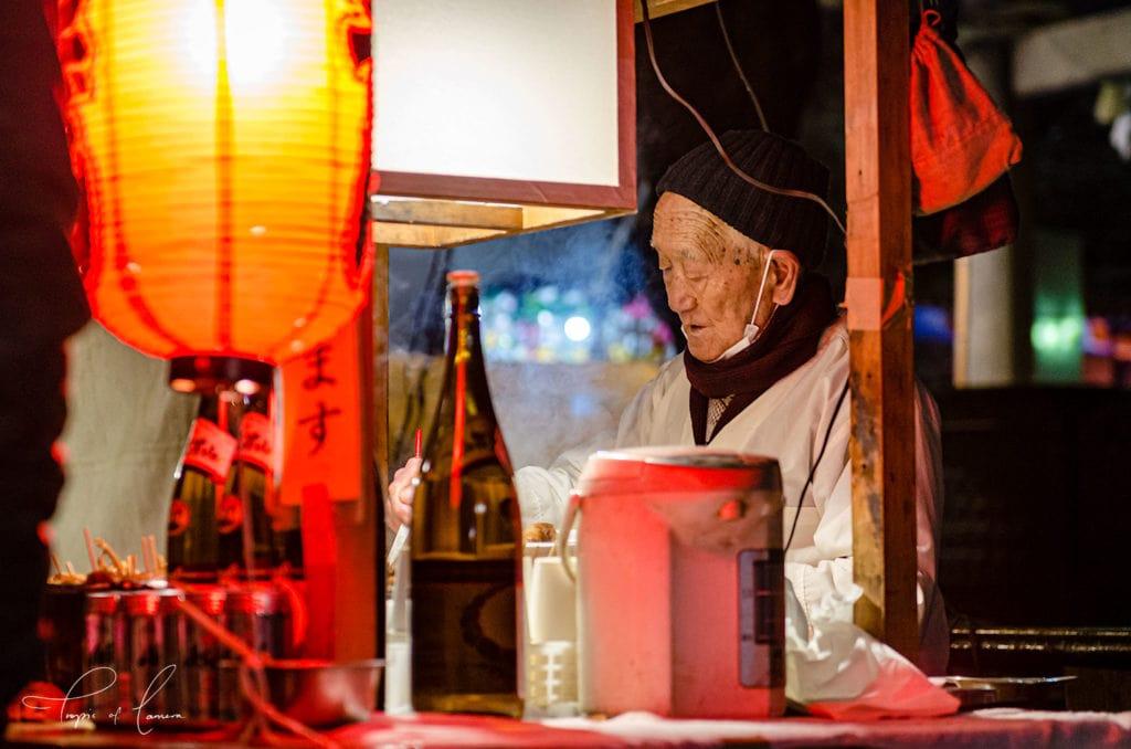 Street food vendor at night in Asakusa, Japan