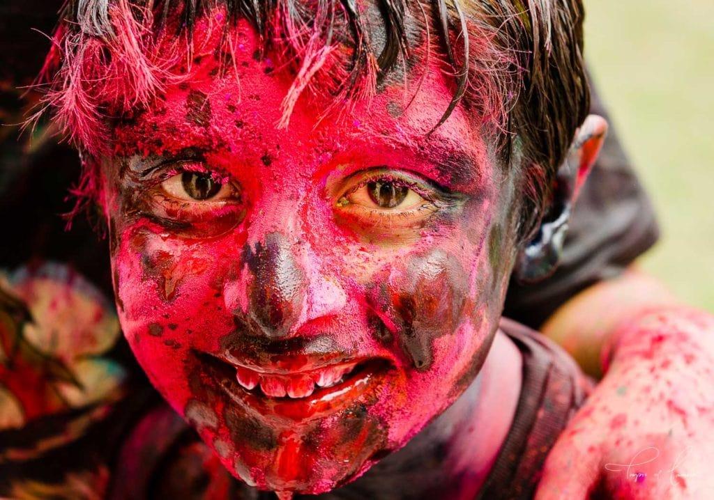 Boy celebrating Holi Festival in Jaipur, India