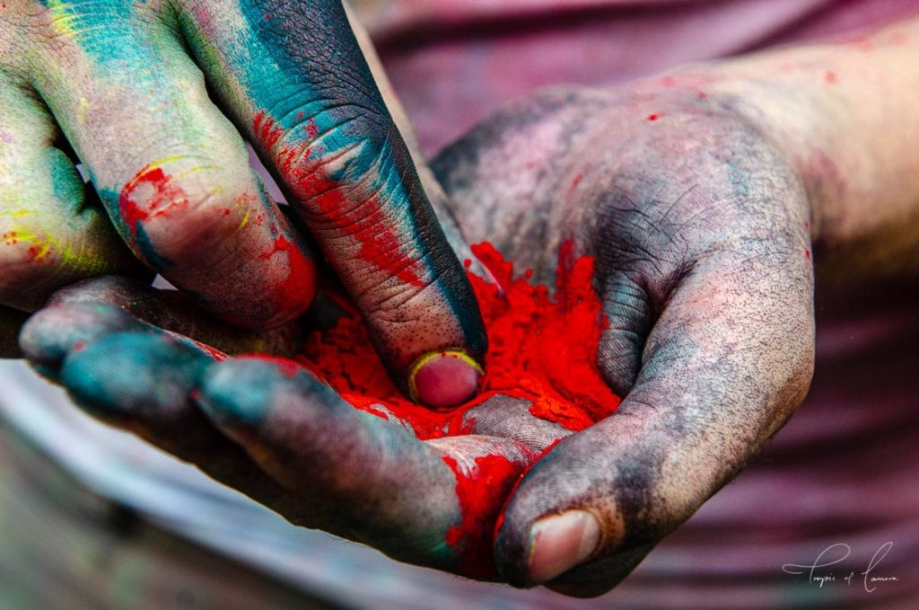 Hands with powder on them from the Holi Festival in India