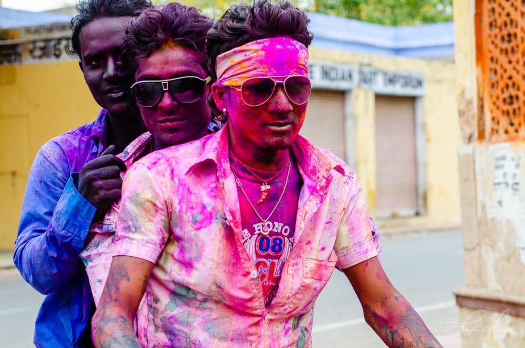 Men celebrating the Holi Festival, India on a motorbike