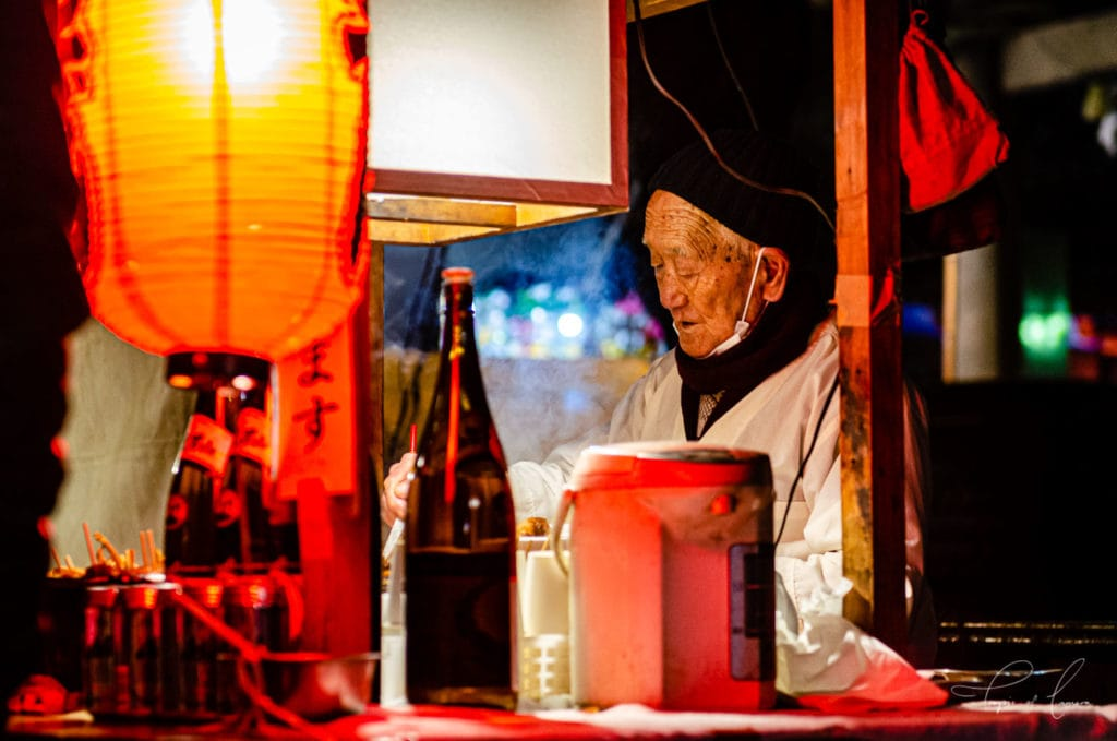 Street food seller at Senso-ji Temple for New Year celebrations in Tokyo, Japan