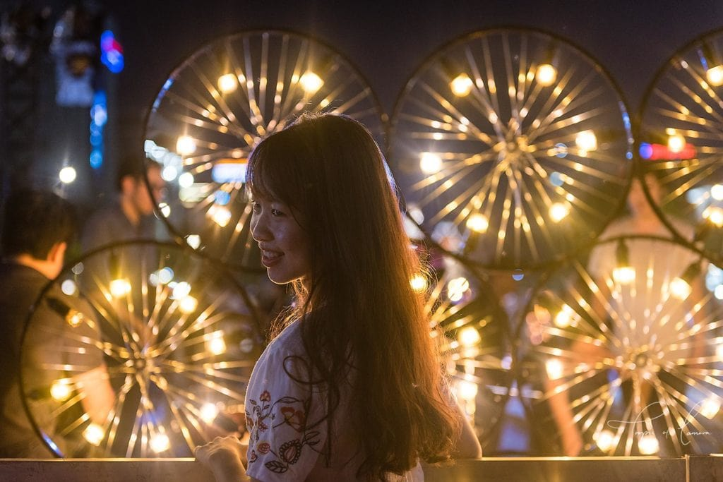 Woman in front of lights, Ho Chi Minh City, Vietnam