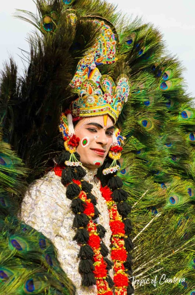 Young man dressed as a god celebrating the Holi Festival in Jaipur
