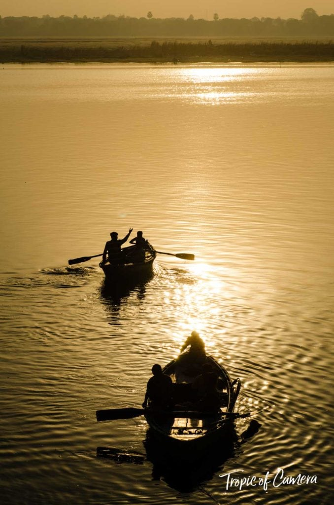 Boats on the Ganges River at sunset in Varanasi