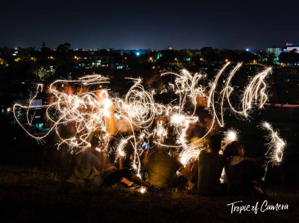 People playing with sparklers
