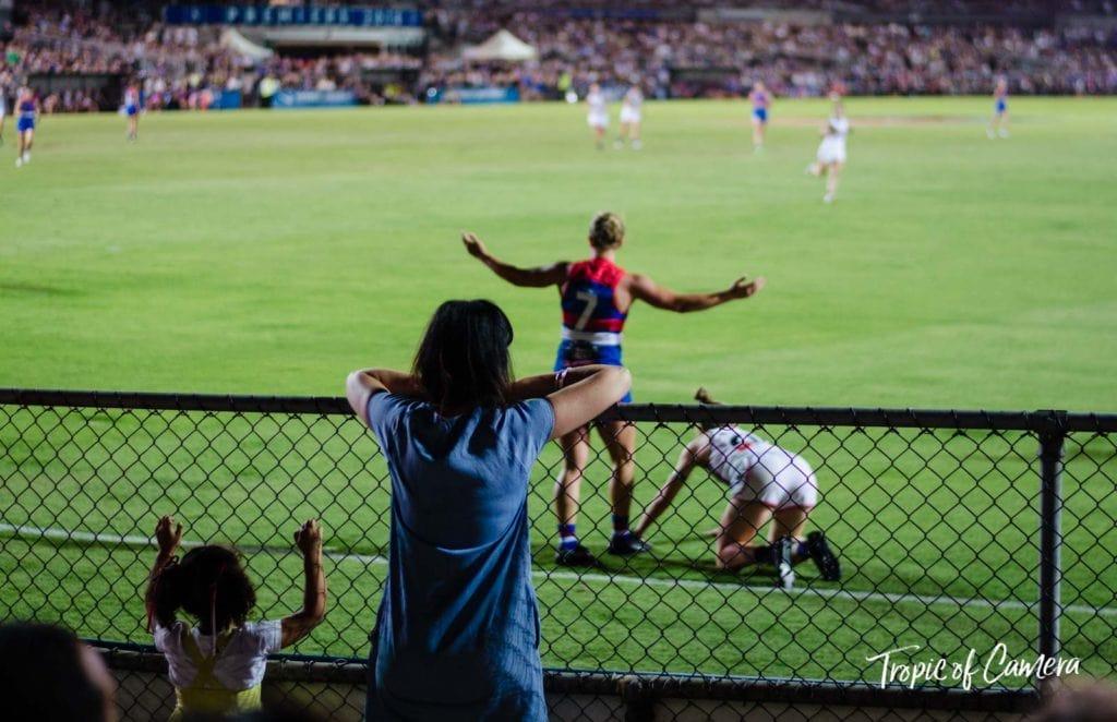 Women watching Western Bulldogs AFLW game