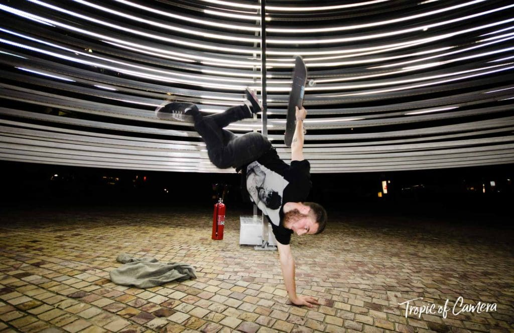 Skateboarder performing against an artwork in Melbourne