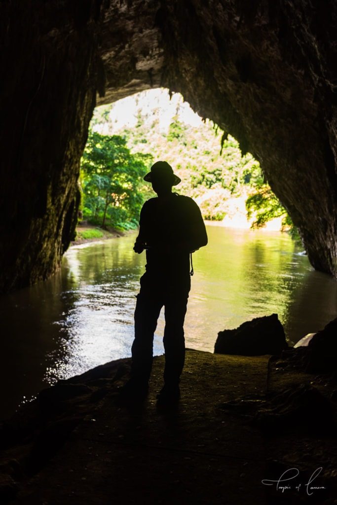 Silhouette of man in cave in Ba Be National Park, Vietnam