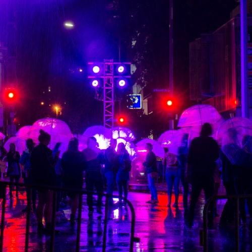 Standing in the rain installation at White Night, Melbourne