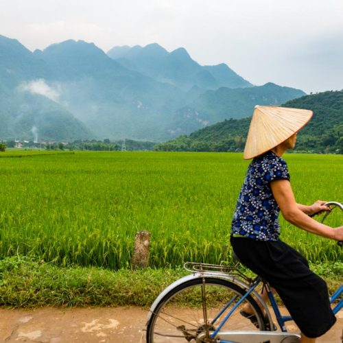 A woman cycling in Mai Chau, Vietnam