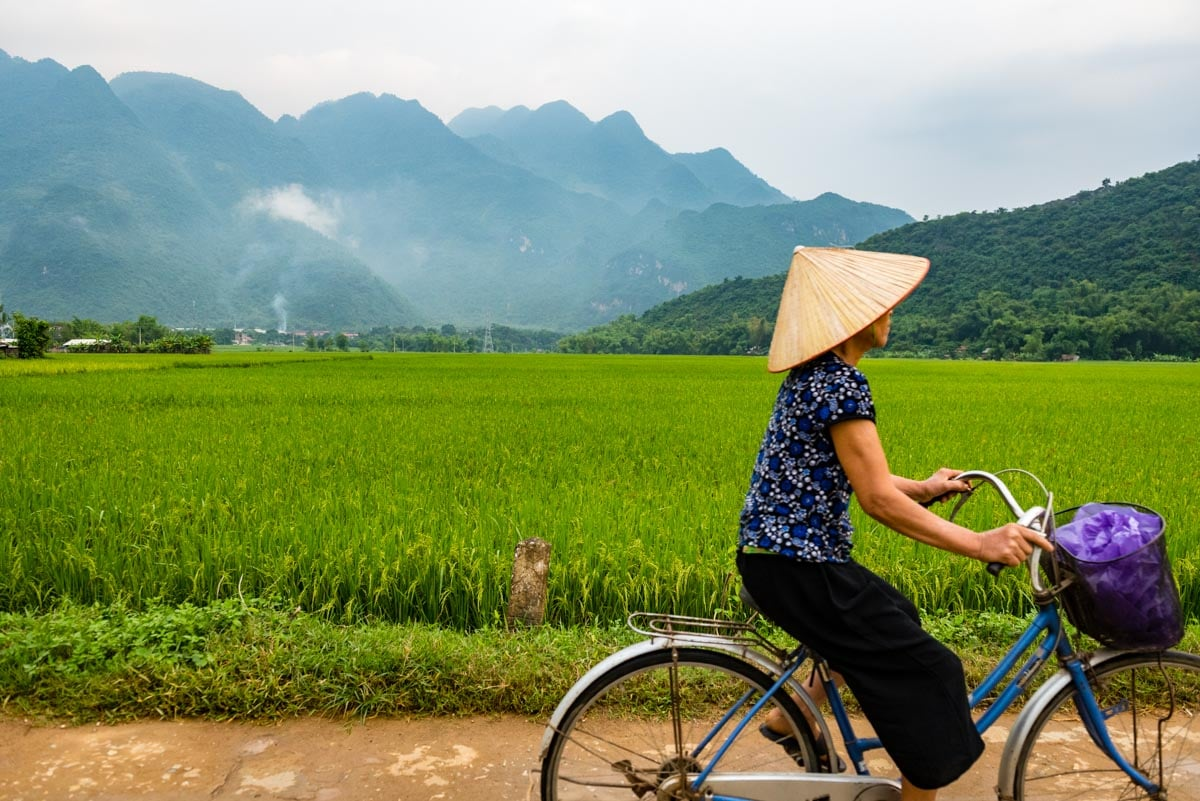 A woman cycling in Mai Chau, Vietnam