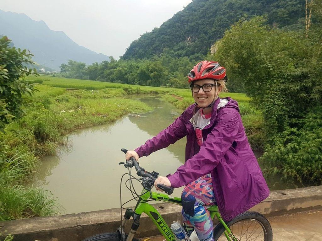 Woman cycling in Mai Chau, Vietnam