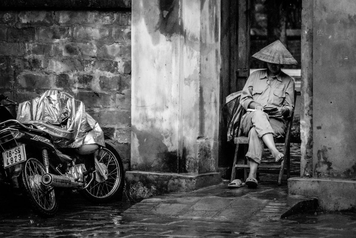 A person resting at the Temple of Literature in Hanoi