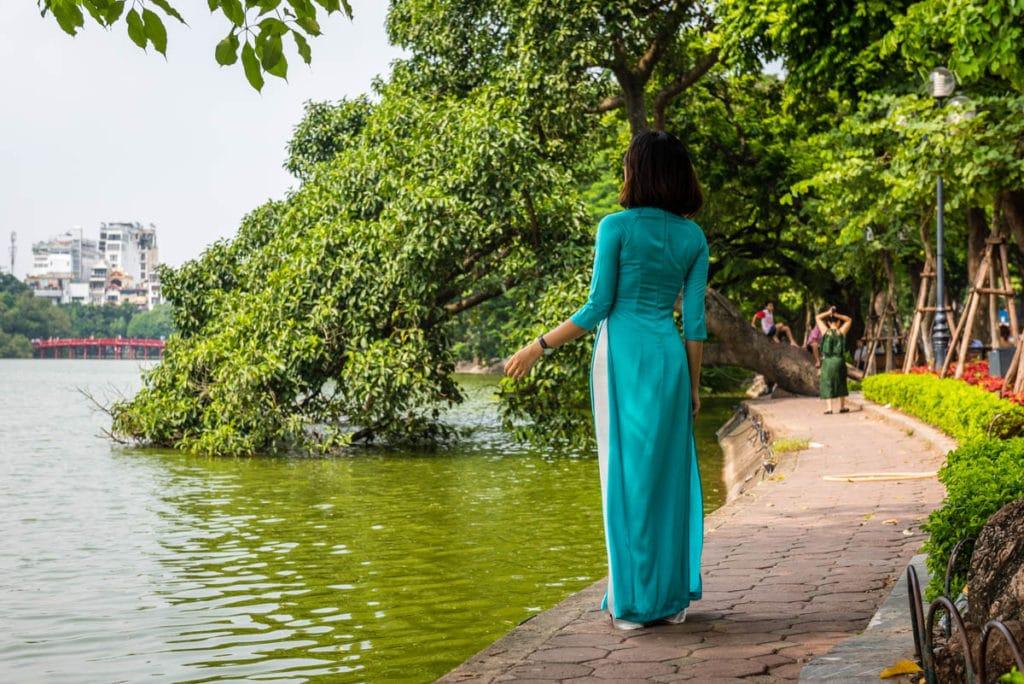 Woman standing at Hoan Kiem Lake