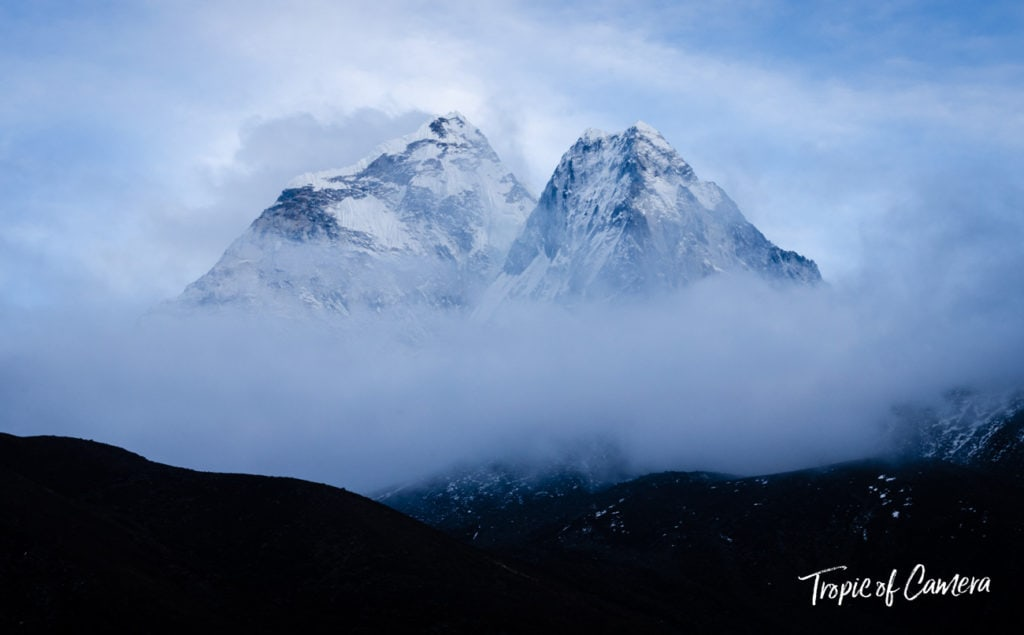 Ama Dablam mountain in the morning light and fog in the Himalayas, Nepal