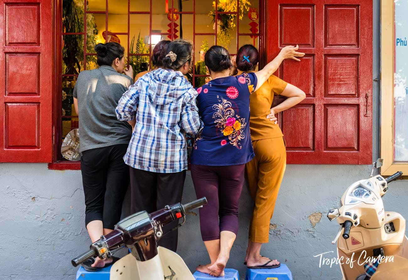 Women watch a performance in a temple in Hanoi