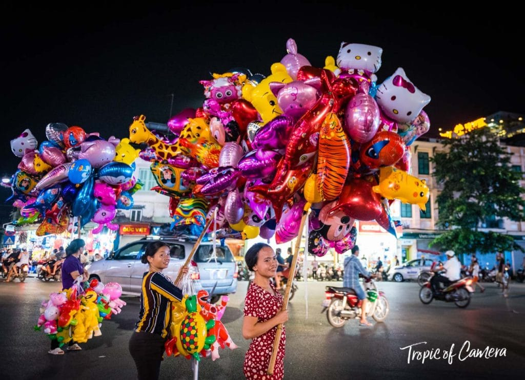Women sell inflated balloons in Hanoi, Vietnam