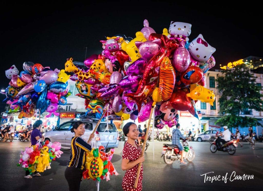 Women sell inflated balloons in Hanoi, Vietnam