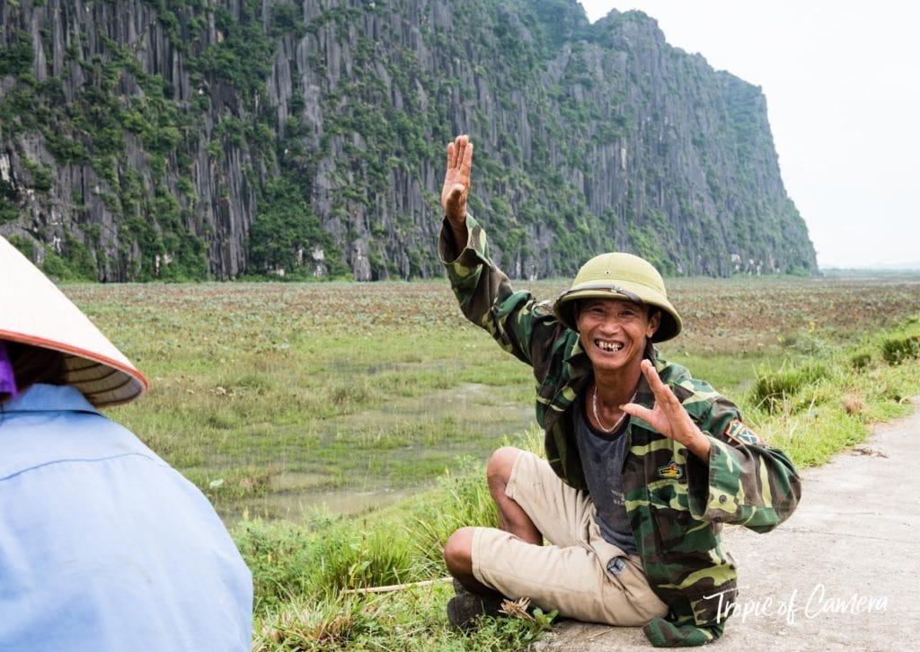 A smiling Vietnamese man at Ninh Binh