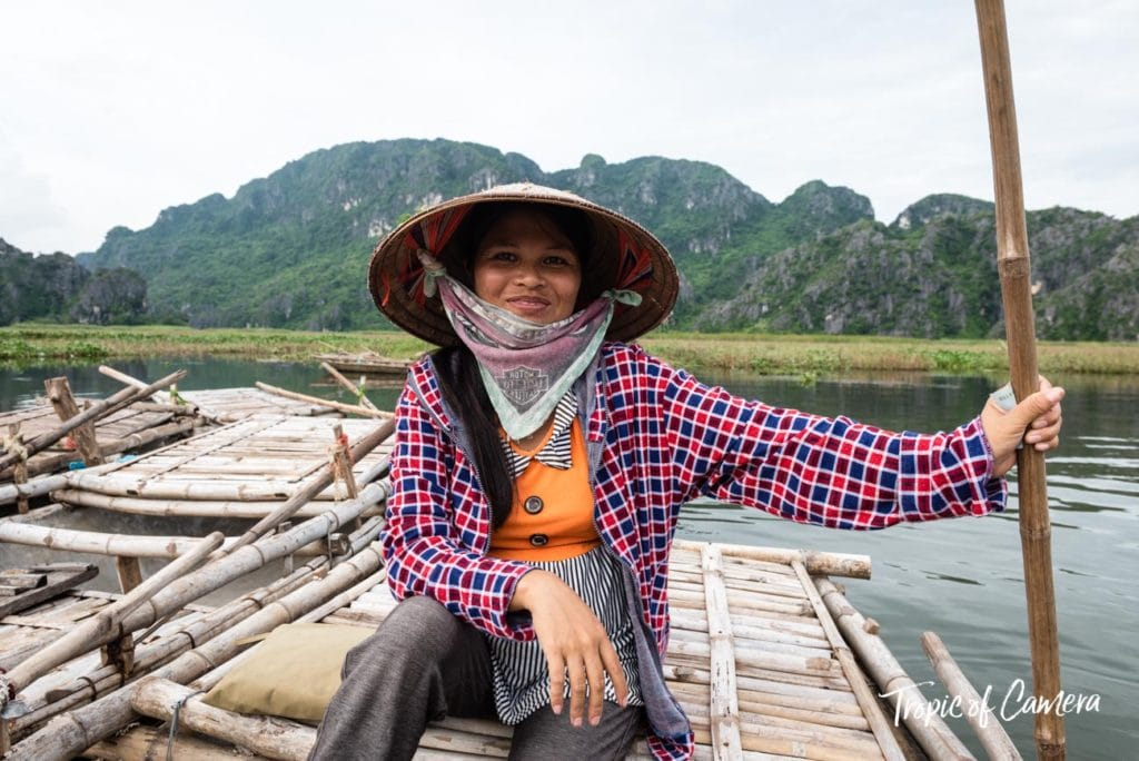 A female boat driver poses for a photo near Ninh Binh, Vietnam