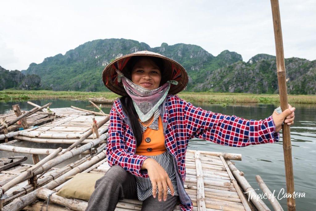 A female boat driver poses for a photo near Ninh Binh, Vietnam