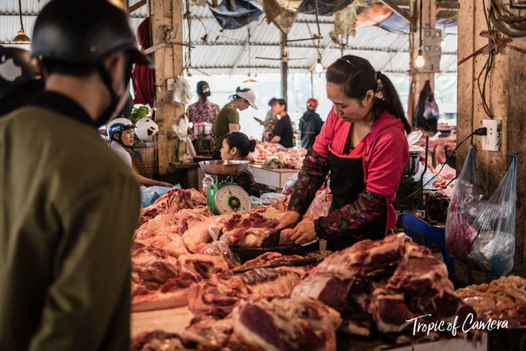 Woman cutting up meat at the Sa Pa Farmers Market