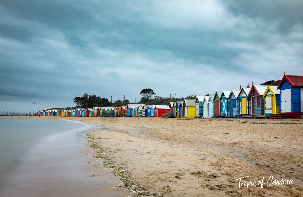 Long exposure photograph of Brighton Bathing Boxes on an overcast day