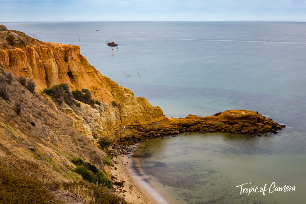 Long exposure photograph of the cliffs at Half Moon Bay with the shipwreck of HMVS Cerberus