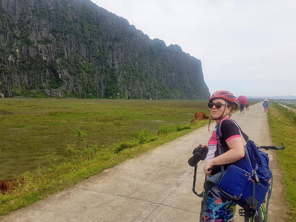 Woman cycling in Vietnam