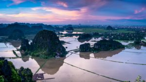 Sunset over karst formations in Ninh Binh, Vietnam
