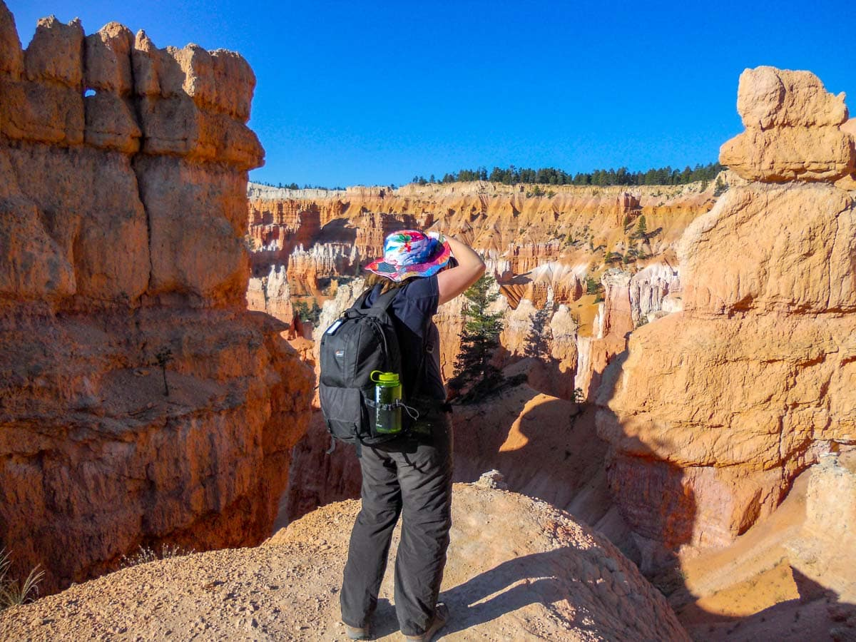 Woman photographing Bryce Canyon, USA