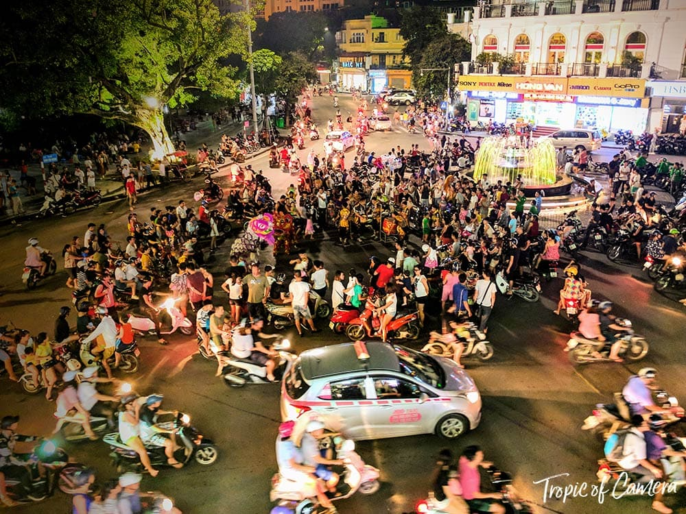 Intersection in Hanoi at night taken on a phone