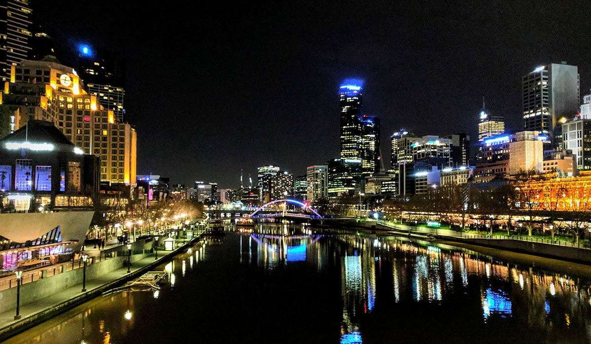 Melbourne city reflected in water at night