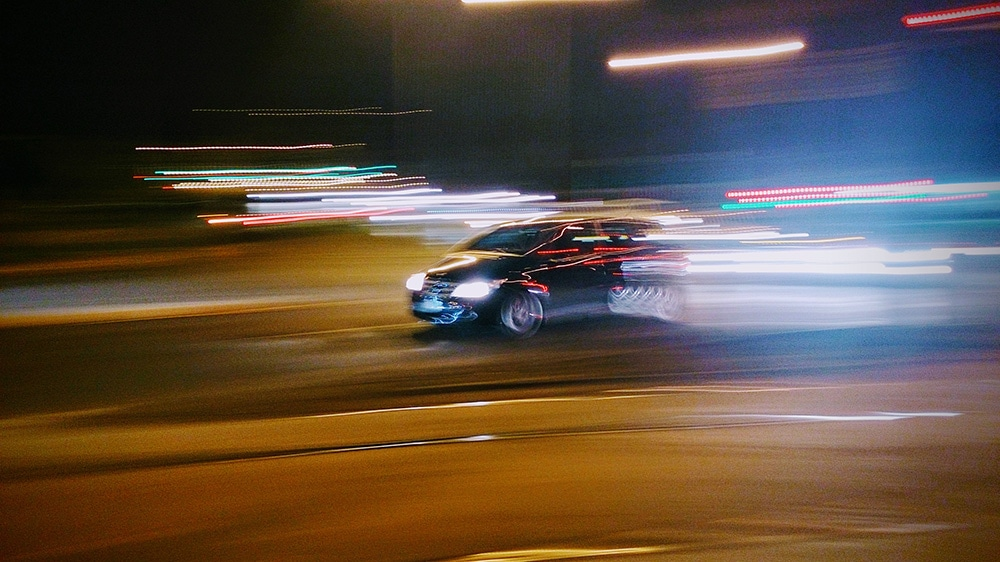 Long exposure of a car moving at night