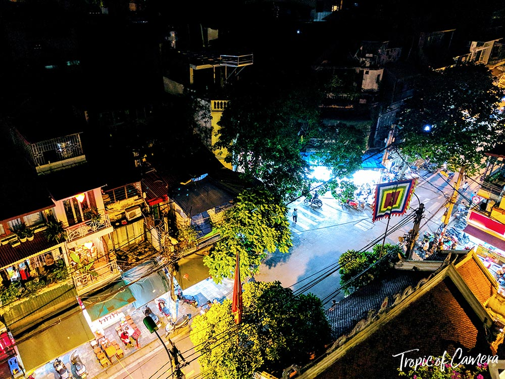 Rooftop shot of a street in Hanoi at night