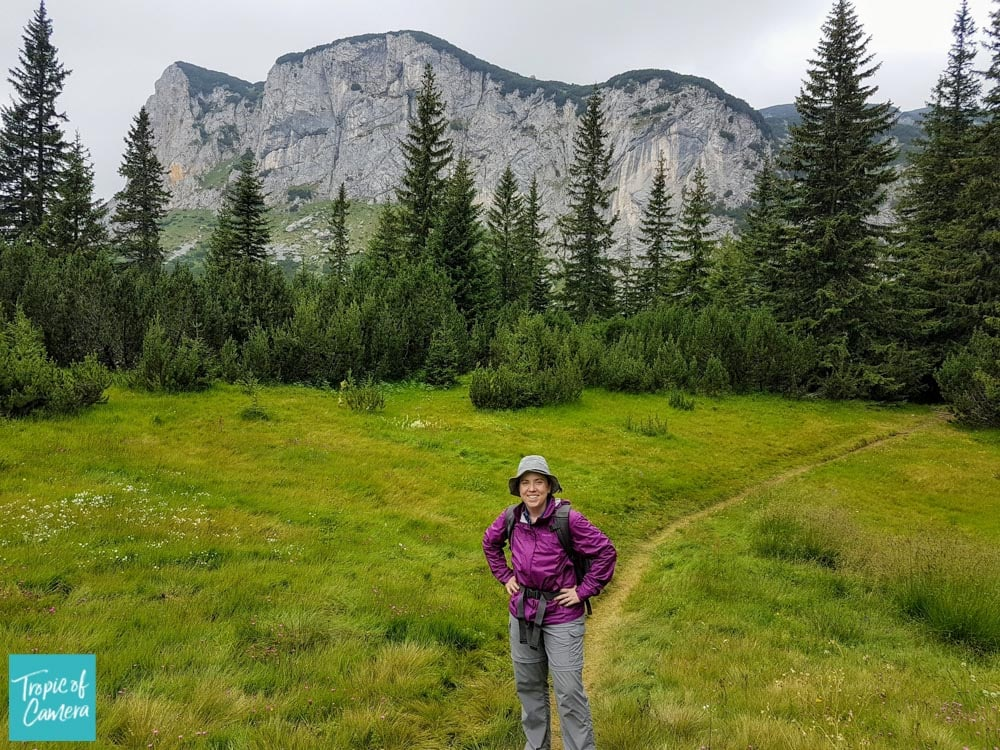 A woman hiking in Durmitor National Park, Montenegro with mountains in the background