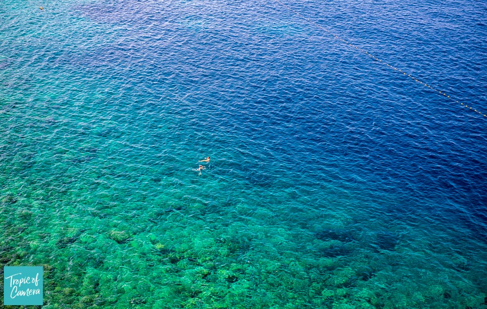 Swimmers in aquamarine water in Croatia
