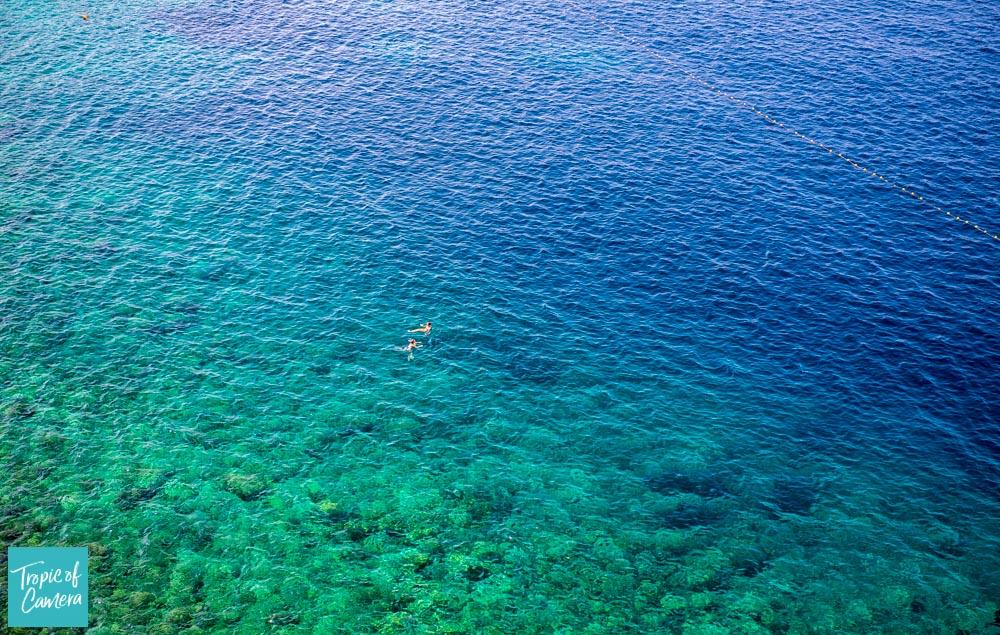 Swimmers in aquamarine water in Croatia