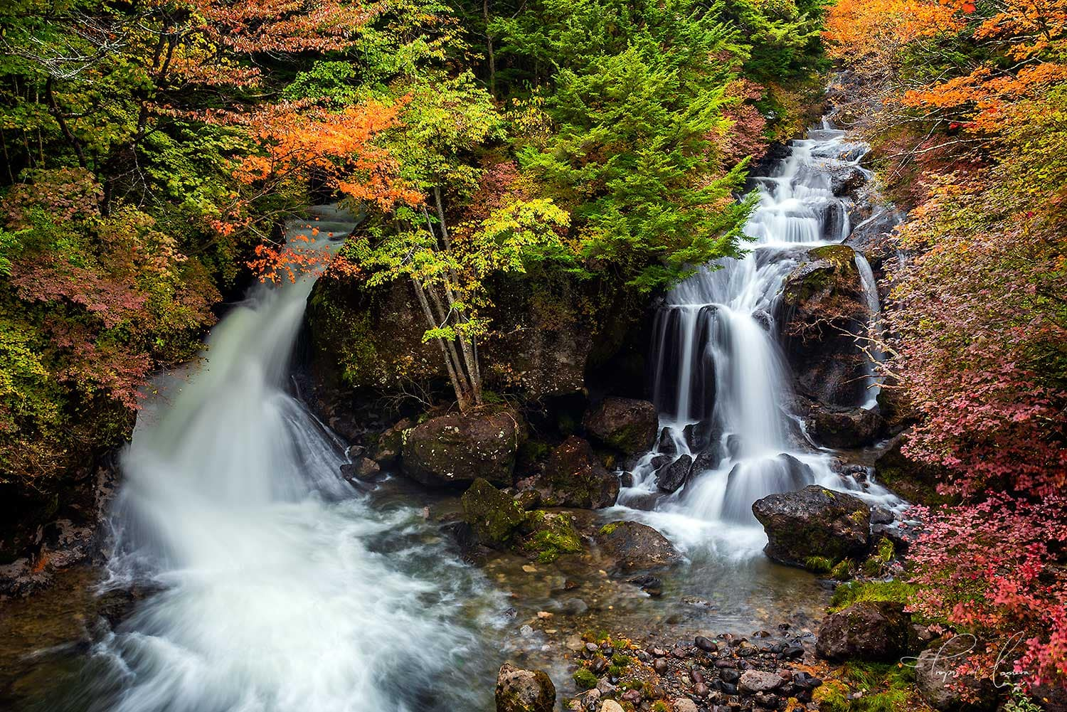 Ryuzu Falls, a dual waterfall surrounded by autumn leaves, Nikko, Japan