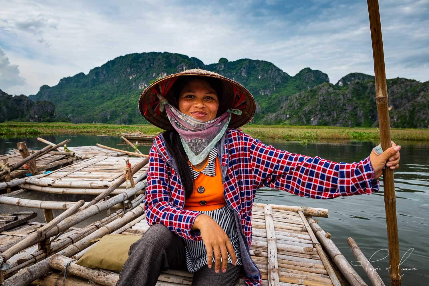 Boat driver smiling for a photo in Ninh Binh, Vietnam