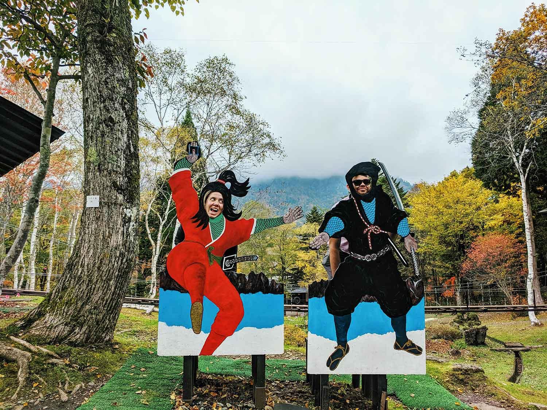 Tourists posing as ninjas at Togakushi ninja museum